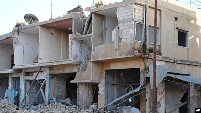 Shops and homes are seen after they were destroyed by Syrian government shelling in Rastan town in Homs province, central Syria, March 20, 2012.