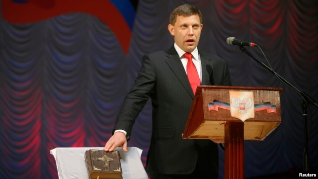 Separatist leader Alexander Zakharchenko is sworn in as the head of the self-proclaimed Donetsk People's Republic during a ceremony at a theatre in Donetsk, eastern Ukraine, Nov. 4, 2014.