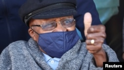 FILE - Archbishop Desmond Tutu gestures after receiving his coronavirus (COVID-19) vaccination in Cape Town, South Africa, May 17, 2021.