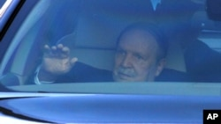 Algerian President, Abdelaziz Bouteflika, seated in a car, leaves the Constitutional Court, in Algiers, March 3, 2014.