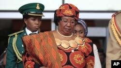 FILE - Malawi's President Joyce Banda attends a seminar on security in Abuja, Nigeria, Feb. 27, 2014.