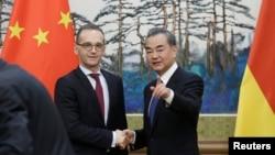 中國外長王毅和德國外長馬斯在北京釣魚台國賓館出席記者會。(2018年11月13日)
