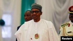 Le président Muhammadu Buhari assiste à l'ouverture de la 56e session ordinaire de l'Autorité des chefs d'État et de gouvernement de la CEDEAO à Abuja, Nigeria, le 21 décembre 2019.