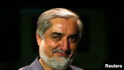 Afghan presidential candidate and former foreign minister Abdullah Abdullah smiles during an interview in Kabul April 9, 2014. Frontrunner to succeed Hamid Karzai as Afghanistan's president, Abdullah, voiced the possibility of teaming up with a rival on W