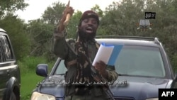 FILE - Video screen shot of Nigerian Islamist extremist group Boko Haram leader Abubakar Shekau delivering a speech at an undisclosed location, Aug. 24, 2014.