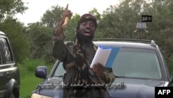 Video screen shot of Nigerian Islamist extremist group Boko Haram leader and obtained by AFP shows Abu Bakr Shekau, delivering a speech at an undisclosed location, Aug. 24, 2014.