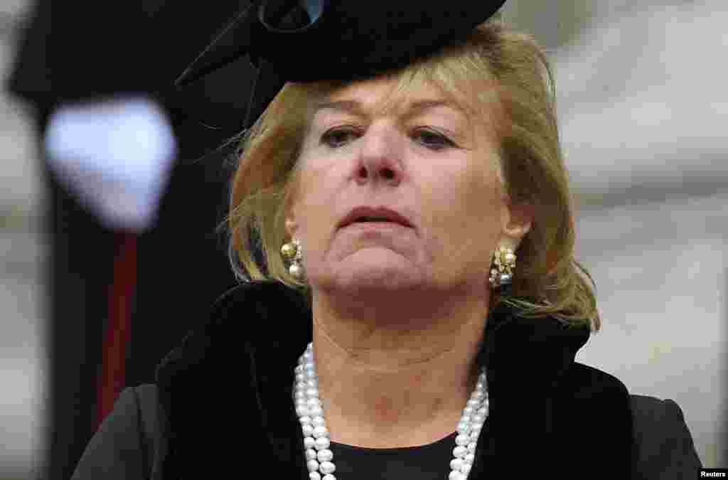Carol Thatcher watches as the hearse carrying her mother, former British prime minister, Margaret Thatcher, is driven away after her funeral service at St Paul's Cathedral, in London April 17, 2013. Thatcher, who was Conservative prime minister between 19