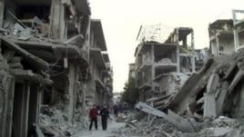 Các tòa nhà ở thành phố Homs bị phá hủy sau các vụ không kích của lực lượng chính phủ, hình chụp ngày 29/11/2012.