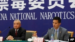 U.S. Drug Enforcement Administration's representative in Beijing, Lance Ho, right, speaks next to Wei Xiaojun, deputy director-general of the Narcotics Control Bureau of the Ministry of Public Security during a press conference in Beijing, Nov. 3, 2017.