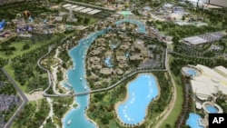 An architectural model view of the central lake and the Lapita hotel at the Dubai Parks and Resorts complex is displayed in Dubai, United Arab Emirates, March 1, 2016.