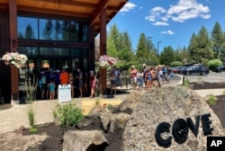 Guests at Sunriver resort near Bend, Oregon line up to get into the pool on June 29, 2021 as temperatures were predicted to hit 106 degrees Fahrenheit.