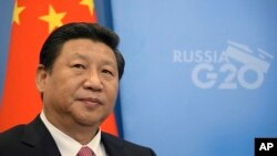 2013年9月5日中国国家主席习近平来到俄罗斯的圣彼得堡参加20国集团峰会的照片。