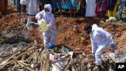 Health workers prepare to burn culled ducks following detection of the H5N8 bird flu strain in Kerala state, India, Jan.5, 2021. Russia said Feb. 20, 2021, that the world's first case of transmission of H5N8 to humans had been detected.