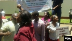 Youths affiliated to the Patriotic Forum for Zimbabwean children of former freedom fighting seen staging a demonstration against targeted sanctions imposed on some Zanu PF officials. (Photo/Irwin Chifera)