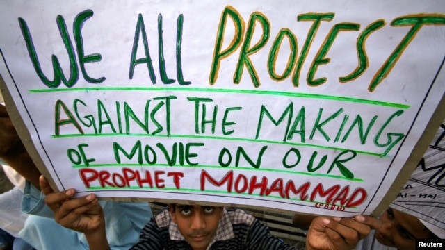 A Muslim youth holds up a placard during a protest against against the anti-Islam film, in Jammu, India Sept. 21, 2012.