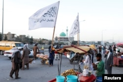 Taliban flags are seen on a street in Kabul, Afghanistan, Sept. 16, 2021