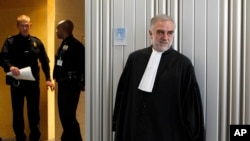FILE - Luis Moreno-Ocampo leaves after a swearing-in ceremony at The International Criminal Court (ICC) in The Hague, Netherlands, Friday, June 15, 2012.