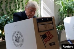 FILE - Republican presidential candidate Donald Trump fills his ballot for the New York primary election in the Manhattan borough of New York City, April 19, 2016.