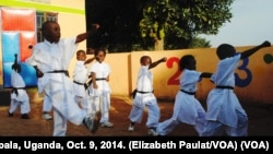 Children learn to kick and punch in Kung Fu classes, Kampala, Uganda, Oct. 9, 2014.