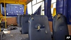 A photo provided by the Ukrainian Interior Ministry shows the inside of a bus destroyed by a shell at the checkpoint near the town of Volnovakha in Donetsk, eastern Ukraine, Jan. 13, 2015.