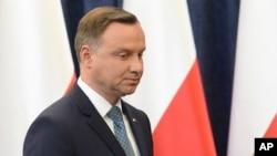 FILE - Polish President Andrzej Duda prepares to make a statement in Warsaw, Poland, July 24, 2017.