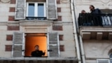 Keeping windows open can help move good air in and bad out. Here, French singer Stephane Senechal sings from his apartment's open window in Paris. A lockdown was imposed to slow the rate of the coronavirus disease (COVID-19) spread, March 24, 2020. REUTERS/Gonzalo Fuentes