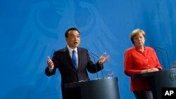 Премьер Государственного совета КНР Ли Кэцян и канцлер Германии Ангела Меркель. Берлин. 9 июля 2018 г.
