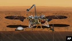 This August 2015 artist's rendering provided by NASA/JPL-Caltech depicts the InSight Mars lander studying the interior of Mars.