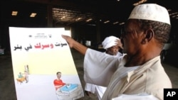 Sudanese election officials check posters to be distributed around Khartoum on March 17, 2010 with the start of the electoral campaign in northern Sudan. The election was also part of the 2005 Comprehensive Peace Agreement that ended over two decades of S