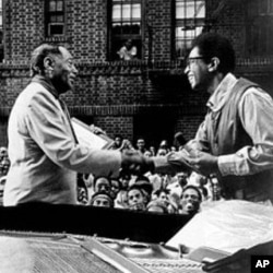 Duke Ellington, left, and jazz pianist Billy Taylor shake hands on New York's Jazzmobile during a visit by the Ellington Band to the city's Harlem section in the early 1970s