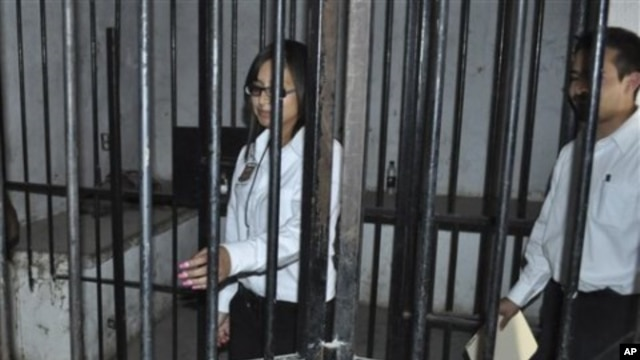 Marisol Valles Garcia, 20, left, inspects the prisoners cell at the police station after her swearing-in ceremony as the new police chief of the border town of Praxedis G. Guerrero, near Ciudad Juarez, Mexico (File Photo - October 20, 2010)