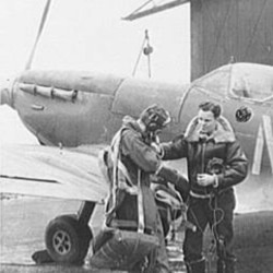 Two American pilots prepare to fly a British Spitfire