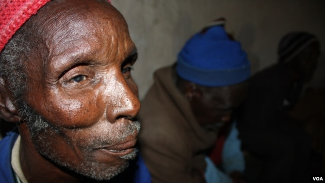 Elderly village residents like Bhasiqhongolo Dodwana are mostly in favor of the community rule designed to prevent alcohol-related violence (D. Taylor /VOA)
