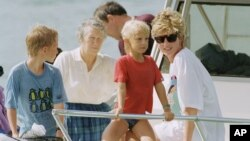 FILE - A photo of Princess Diana and sons Harry and William at Banana Bay Beach, St. Kitts, Jan. 4, 1993.