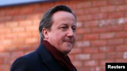 FILE - Britain's Prime Minister David Cameron arrives for his visit to the Harris City Academy in south London, Dec. 8, 2014.