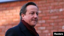 Britain's Prime Minister David Cameron arrives for his visit to the Harris City Academy in south London, Dec. 8, 2014.