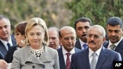 Yemeni President Ali Abdullah Saleh, right, walks with U.S. Secretary of State Hillary Rodham Clinton, as she arrives at the Presidential Palace in Sanaa, Yemen, Tuesday, Jan. 11, 2011.