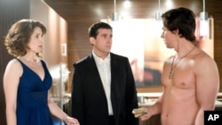 Tina Fey (Claire Foster) and Steve Carell (Phil Foster) star in 'Date Night;' Mark Wahlberg spends much of the movie shirtless as a handsome playboy security expert who helps the Fosters escape