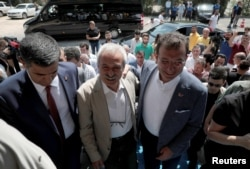 FILE - Mayor of Istanbul Ekrem Imamoglu, right, visits dismissed Diyarbakir Mayor Selcuk Mizrakli in Diyarbakir, Turkey, Aug. 31, 2019.
