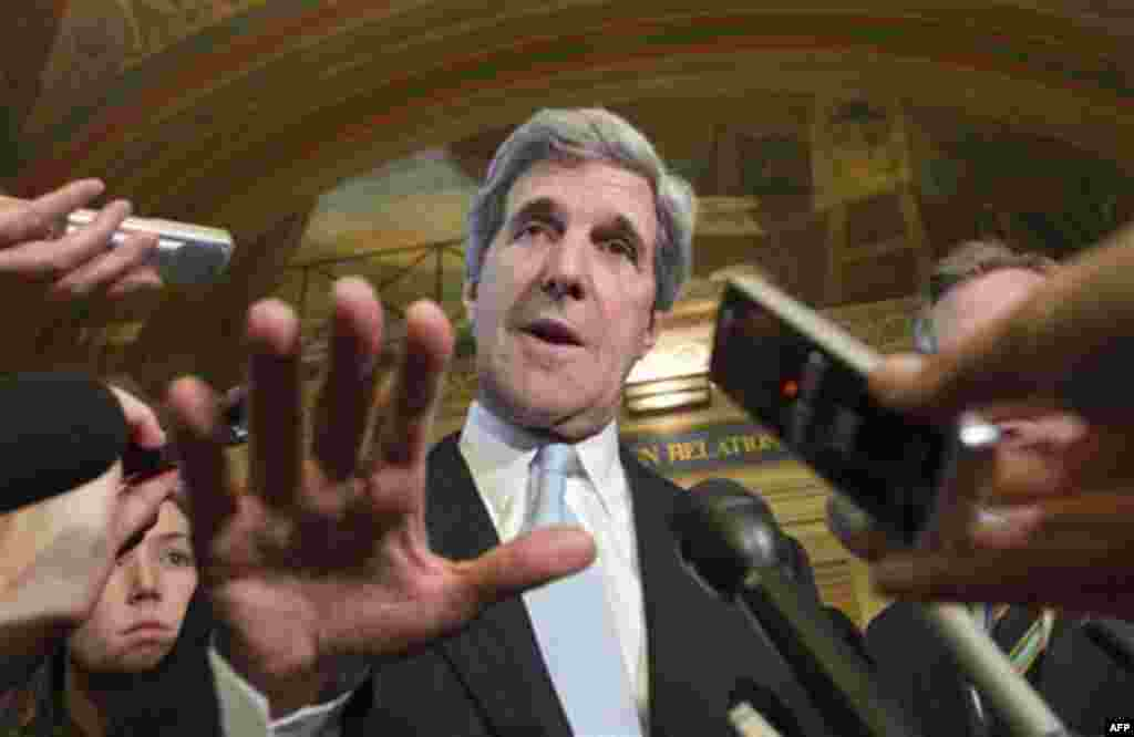 FILE - In this Nov. 17, 2011 file photo, Sen. John Kerry, D-Mass., and other Democratic members of the supercommittee, comment to reporters as they emerge from a closed-door meeting at the Capitol, in Washington. Fanning out to the sets of various talk sh
