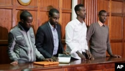 Left to right, Hussein Hassan Mustafah, Adan Dheq, Liban Abdullah Omar, and Mohamed Ahmed Abdi, who are charged with aiding the gunmen involved in the Westgate Mall attack in Sept. 2013, appear during their ongoing trial at Milimani court in Nairobi, Kenya, Dec. 20, 2018.