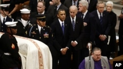 President Barack Obama, Vice President Joe Biden, former President Bill Clinton, and Senate Majority Leader Harry Reid of Nevada stand as the casket is brought in at the funeral service for the late Sen. Daniel Inouye, D-Hawaii, at the Washington National
