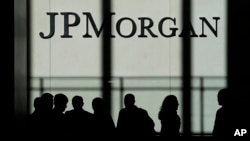 FILE - The JPMorgan Chase & Co. logo is displayed at their headquarters in New York, Oct. 21, 2013.