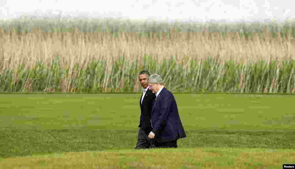 U.S. President Barack Obama walks with Canadian Prime Minister Stephen Harper during the G8 summit at Lough Erne Resort in Enniskillen, Northern Ireland, June 18, 2013.