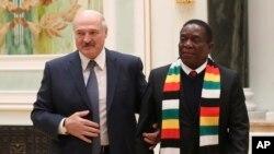 Belarus' President Alexander Lukashenko, left, and Zimbabwe's President Emmerson Mnangagwa prior to their meeting in Minsk, Belarus, Thursday, Jan. 17, 2019. (Natalia Fedosenko/TASS News Agency Pool Photo via AP)
