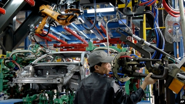 FILE - A worker checks a new assembly line at the Ford Hai Duong production facility in Hai Duong, Vietnam.