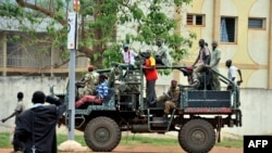 FILE - A truck with former Seleka coalition rebels drives through Bangui, Central African Republic, Oct. 7, 2013.
