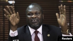 FILE - South Sudan's rebel leader Riek Machar addresses a news conference in Uganda's capital Kampala, Jan. 26, 2016.
