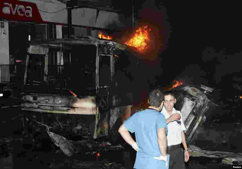 Officials work at the scene of an explosion in the southeastern Turkish town of Gaziantep, August 20, 2012.