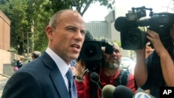 FILE - Michael Avenatti, attorney for adult actress Stormy Daniels, talks to the media outside of Los Angeles County Superior Court after a hearing in Los Angeles, July 10, 2018.